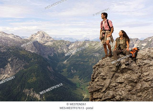 Austria, Salzburger Land, couple on mountain top