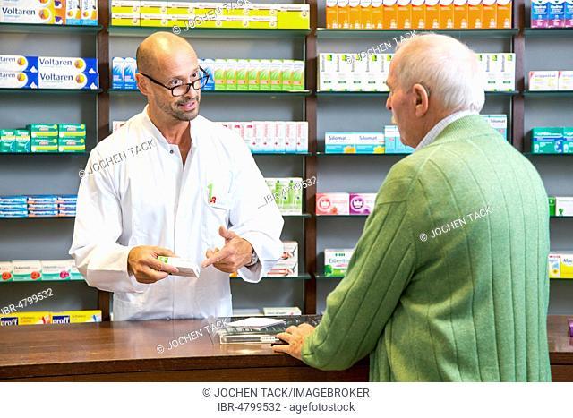 Pharmacy, Pharmacist advises a customer picking up a medicine on prescription, Germany