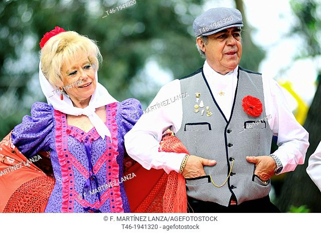 Couple wearing traditional costumes during San Isidro fair, Madrid, Spain