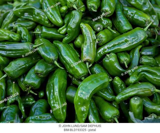 Close up of pile of green chilies
