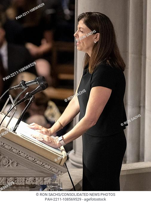 Former United States Senator Kelly Ayotte (Republican of New Hampshire) reads a passage at the funeral service for the late United States Senator John S