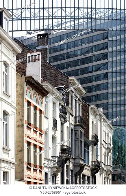 Traditional residential houses in European Quarter of Brussels, in background - The Charlemagne building, a high-rise which houses the Directorate-General for...