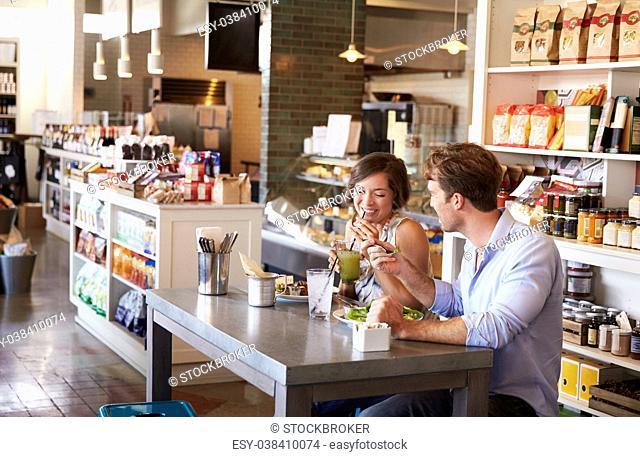 Couple Enjoying Lunch Date In Delicatessen Restaurant
