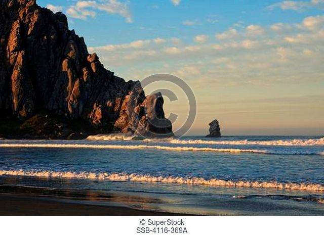 Rock formations in an ocean, Morro Rock, Morro Bay, California, USA