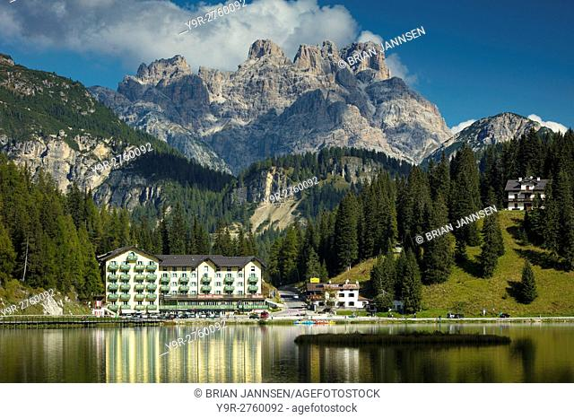 Reflections of the Grand Hotel Misurina in Lago Misurina with the Cristallo looming beyond, Dolomites, Belluno, Italy