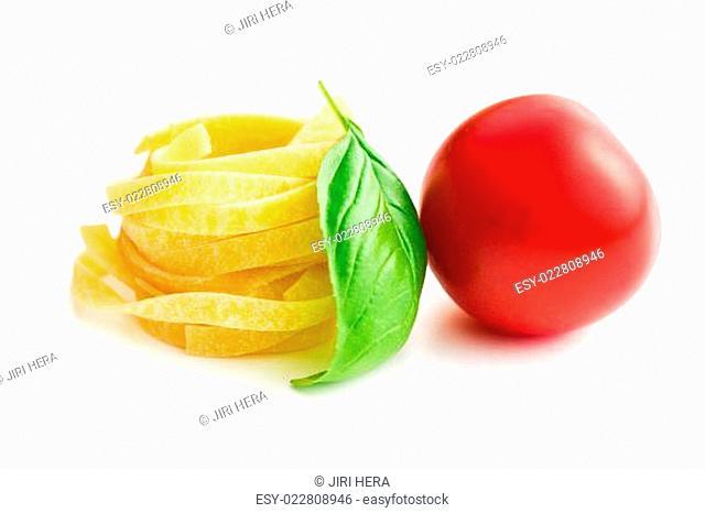 italian pasta tagliatelle, tomato and basil leaf