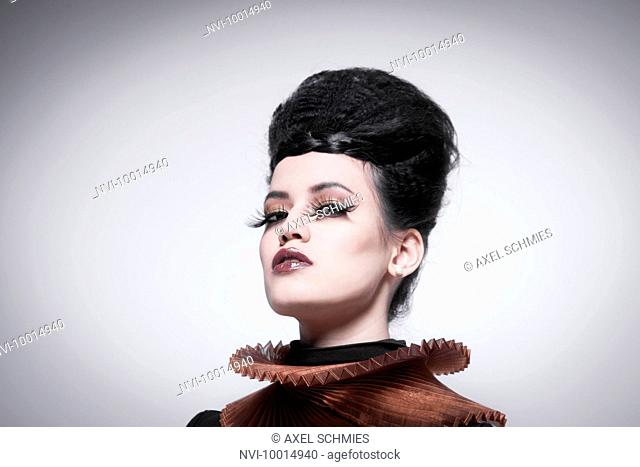 Young woman with eyeshadow, false eyelashes and collar