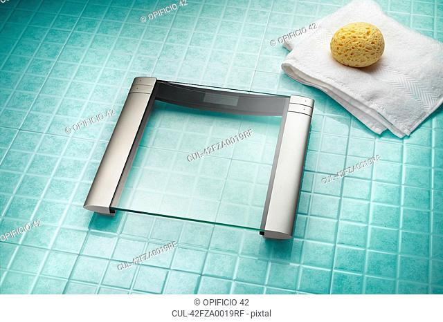 Modern weighing scale on bathroom floor