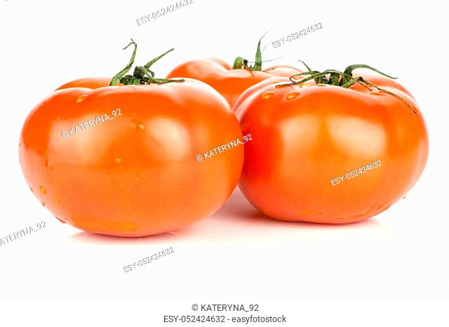 Three red tomato with vine ends isolated on white background fresh whole