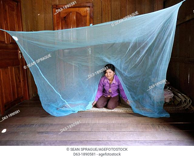 CAMBODIA. Projects of DPA in Stung Treng, supported by SCIAF. Katot village. Case study of Mrs Thong Leung, 35, who has a fish pond. Mosquito net