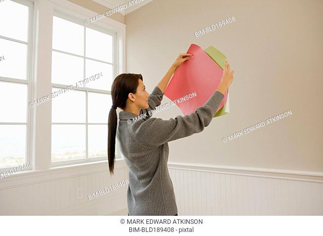 Hispanic woman holding color swatches