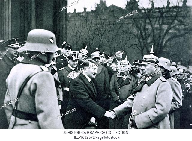 Adolf Hitler shaking hands with President von Hindenburg on the State Day of Honour, 25th February, 1934. From Deutsche Gedenkhalle: Das Neue Deutschland...