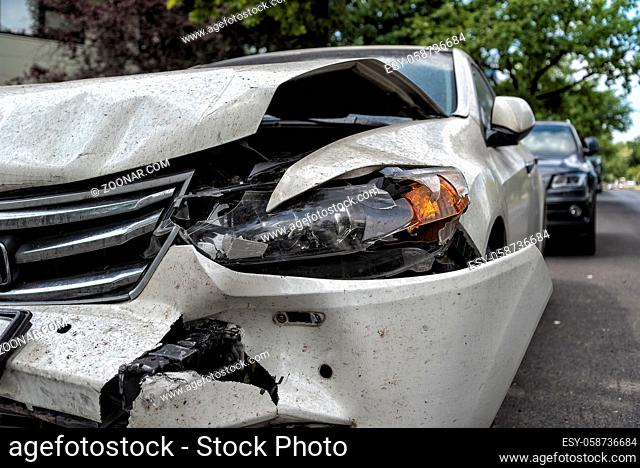 heavy damaged car at the roadside after an accident