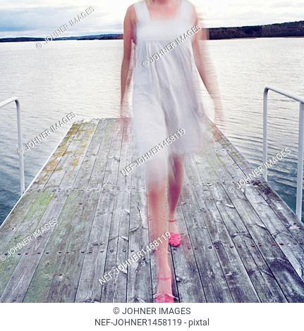 Woman walking on a boardwalk