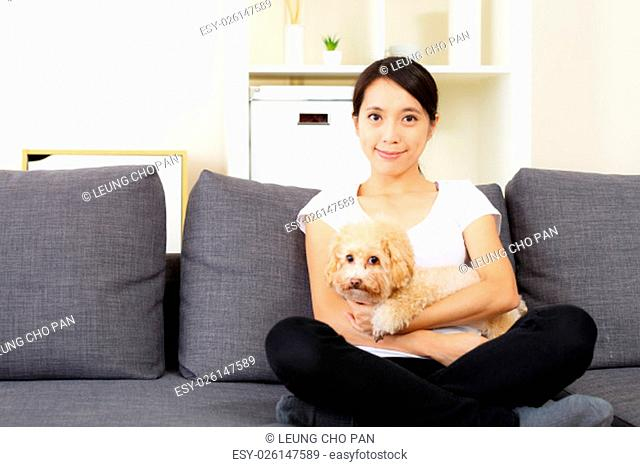 Asia woman and poodle dog at home