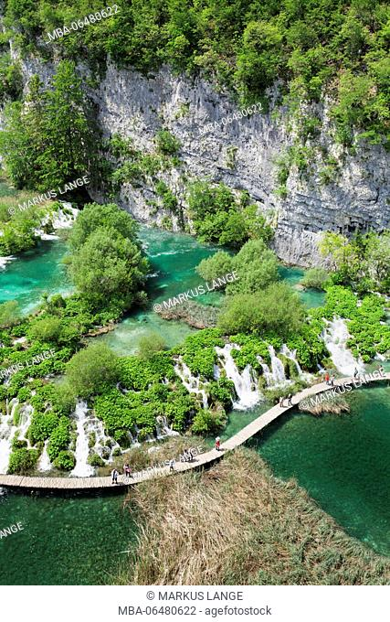Wooden jetty through the lower lakes, national park Plitvicer lakes, UNESCO world nature heir, Croatia