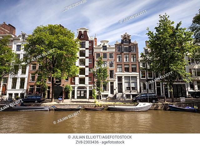 A canal in Amsterdam, Netherlands. The canals of central Amsterdam have been designated a World Heritage Siye by UNESCO