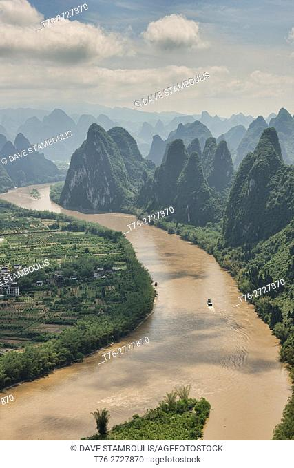 Boat traveling up the scenic Li River, Xingping, Guangxi Autonomous Region, China