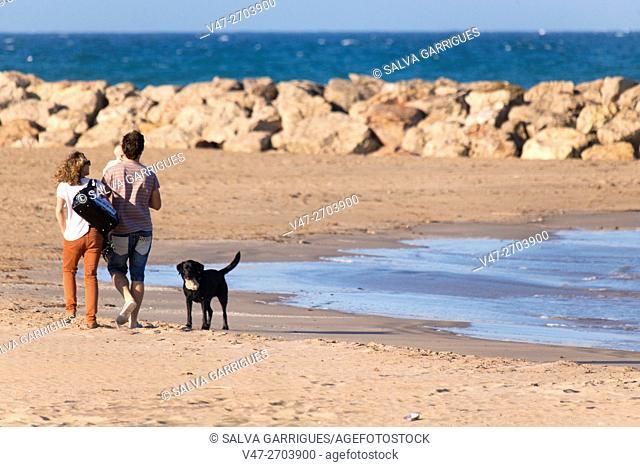 Family walking along the beach Cullera, Valencia, Spain, Europe
