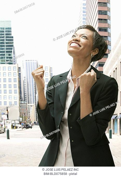 African businesswoman gesturing and smiling