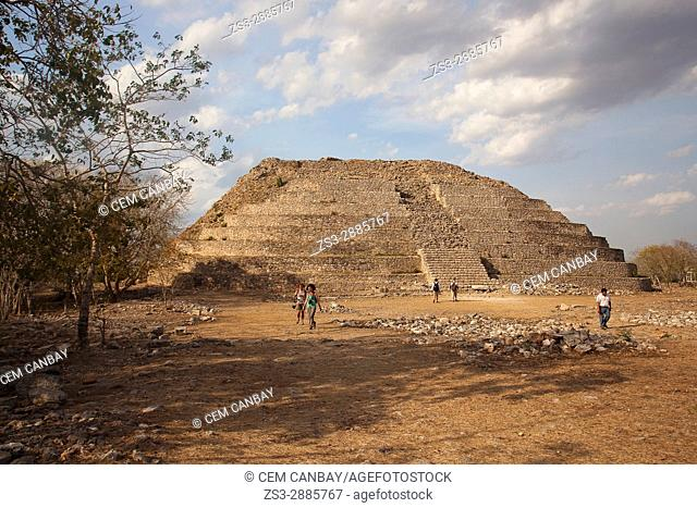 Tourists in front of the Kinich Kak Moo Temple near the town center, Izamal, Yucatan Province, Mexico, Central America