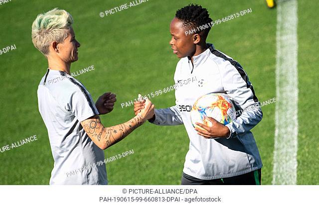 15 June 2019, France (France), Lavérune: Football, women: World Cup, national team, South Africa, training: Janine Van Wyk (l) and Bongeka Gamede shake hands
