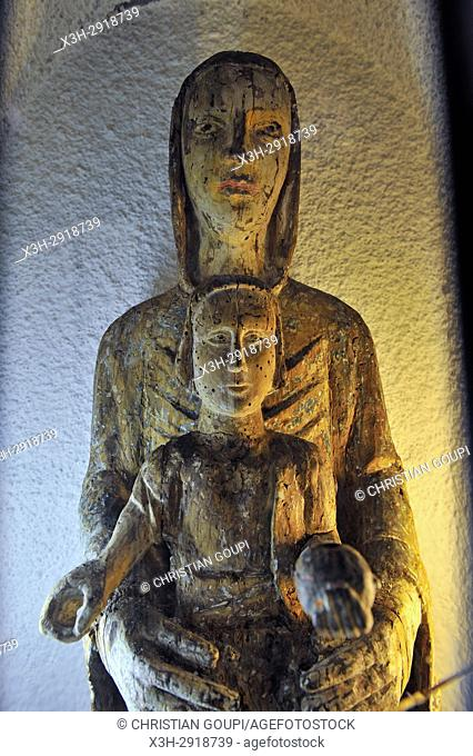 statue of Our Lady from 13 th century inside the Romanesque Church of Lisseuil, Puy-de-Dome department, Auvergne-Rhone-Alpes region, France, Europe