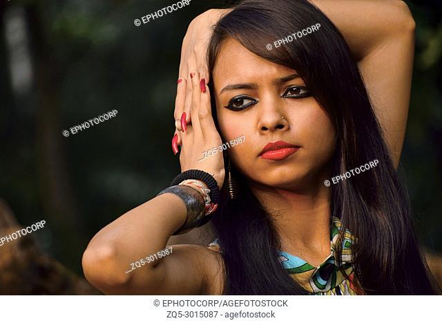 Young girl looking at camera. Pune, Maharashtra