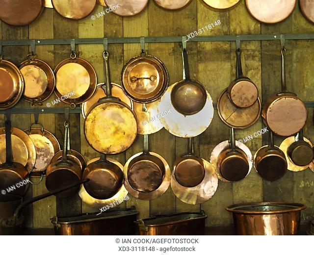 brass pots and pans in the kitchen, Chateau Bridoire, Dordogne Department, Nouvelle-Aquitaine, France