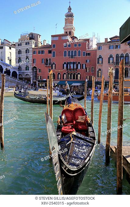 Gondolas by the Rialto Bridge on the Grand Canal, Venice, Italy