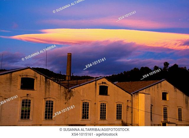 Old industry and luminous cloud.Colonia Valls (was founded in 1903), Valls de Torroella, Sant Mateu de Bages, Barcelona, Catalonia, Spain, Europe
