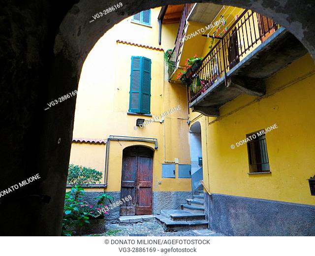 Bellano, Province of Lecco, region Lombardy, eastern shore of Lake of Como, Italy. An inner courtyard in the center of town