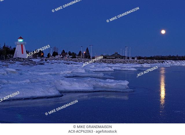 Lighthouse on Georgian Bay (Lake Huron), South Baymouth, Manitoulin Island, Ontario, Canada with full moon in winter