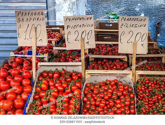 Variety of tomatoes for sale on daily outdoor market in Syracuse city, southeast corner of the island of Sicily, Italy