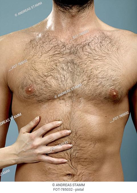 Mans chest touching woman Body language:
