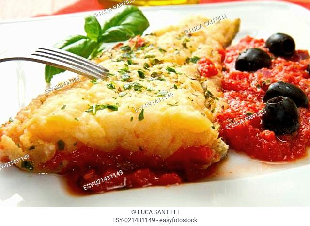 cooked cod loins with home made tomato sauce and oil