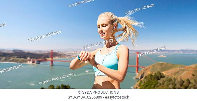 woman with fitness tracker over golden gate bridge