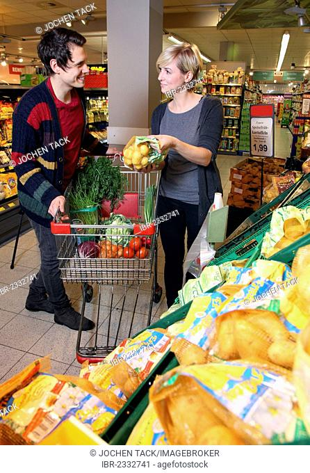 Fruit and vegetable section, couple buying vegetables, food hall, supermarket, Germany, Europe