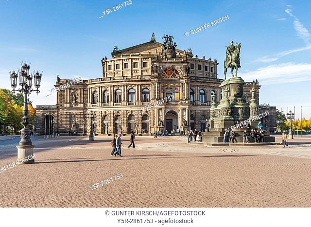 Theaterplatz with Semperoper and equestrian statue of King Johann of Saxony. The Semperoper is the opera house of the Saechsische Staatsoper Dresden (Saxon...
