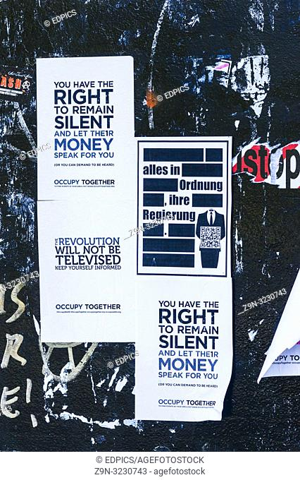 posters by the occupy movement, text reads: -you have the right to remain silent and let their money speak for you, everything is allright, your government-