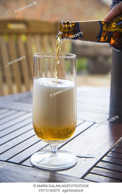 Bottle pouring beer in a glass