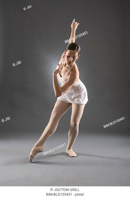 Hispanic ballet dancer posing on tip toe