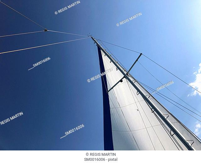 Sail of a sailboat against the sky