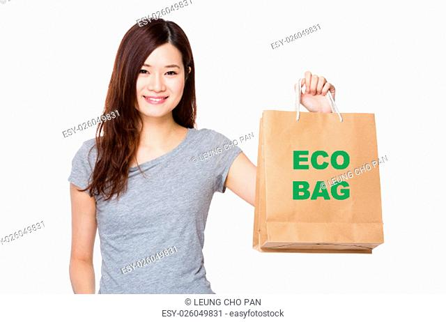 Asian Woman hold with shopping bag for showing phrase of eco bag