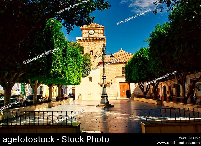 Front view of Santa Maria Parish Church and the central square in Nijar, Spain