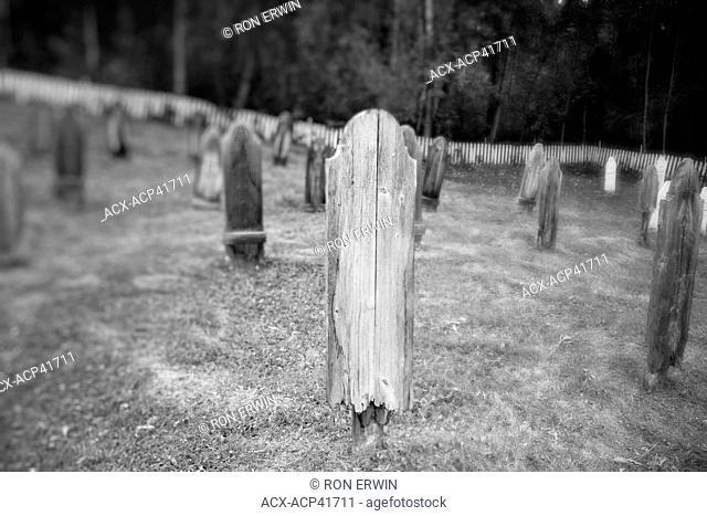 Black and white image of the Yukon Order of Pioneers 8th Avenue Cemetery, Dawson City, Yukon, Canada