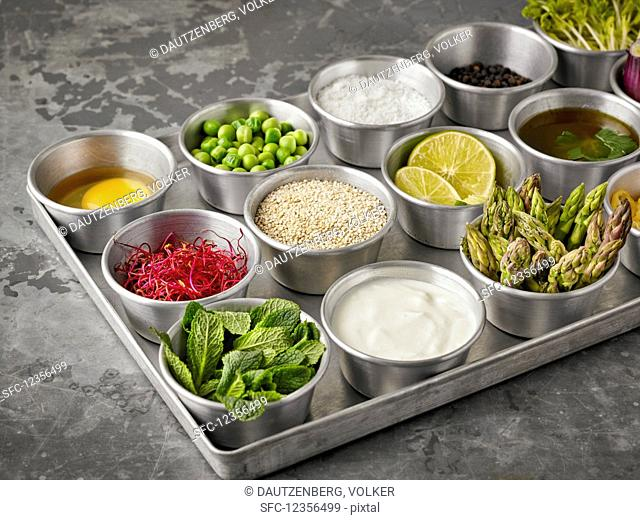 Ingredients for making quinoa burgers and muffins in small bowls