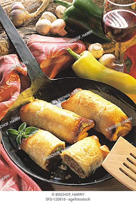 Puff Pastry Rolls with ground Meat Stuffing in Cast Iron Pan