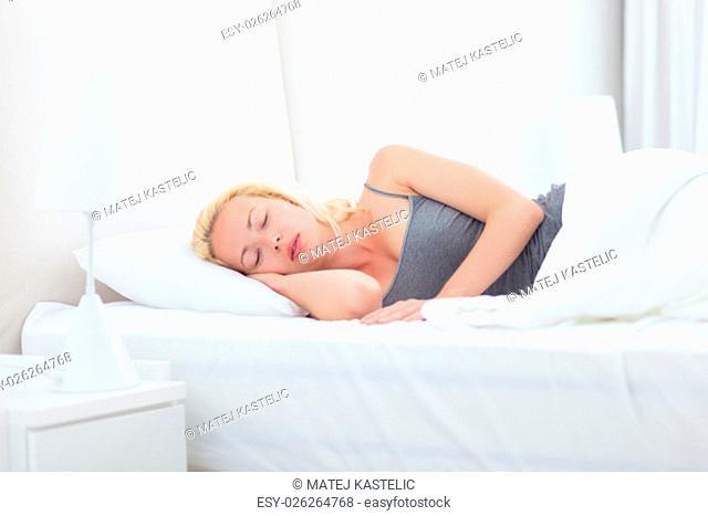 Young beautiful blonde woman sleeping peacefully. Joy and happiness. Beauty sleep. Power nap