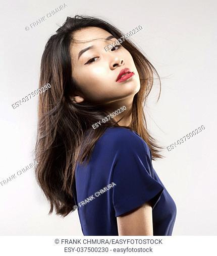 Studio Portrait of a Teenage Girl in Blue Top